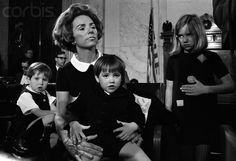 Ethel Kennedy holding Max. Christopher is on left and Kerry is on right