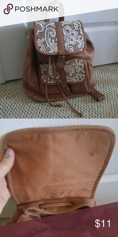 Faux tan leather and cream lace boho backpack Faux tan leather and cream lace backpack in good condition.  There is some staining on the lining but no rips of tears.  Adorable boho style.  I'm open to offers and willing to discount on bundles. Bags Backpacks