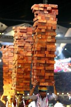 To carry 100 bricks on your own head
