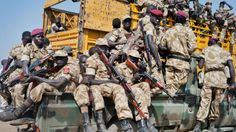South Sudan government soldiers board trucks and pickups, to head to the frontlines to reinforce other government forces already fighting rebel forces near the town of Bor.