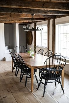 The dining room, with black spindle-back chairs and original wide-plank flooring. Design Furniture, Rustic Furniture, Home Furniture, Dining Room Design, Dining Room Table, Dining Set, Small Dining, Dining Room In Kitchen, Kitchen Curtains