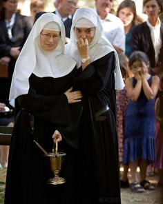 BETHLEHEM, CT- 10 OCTOBER 2005-Sister Chava Palmer and Sister Alma Egger of the Abbey of Regina Laudis watch as the casket of Lady Abbess Be...