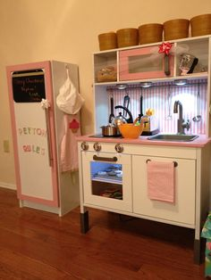 Ikea play kitchen Fridge made from Ikea Billie cabinet - I picture our set looking like this but white/black/silver
