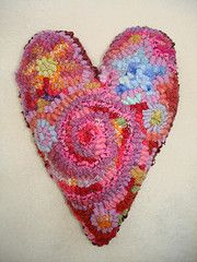Beautiful whimsical rug hooked heart!