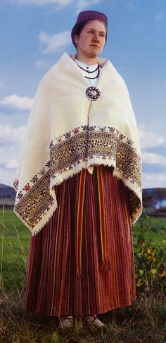 Europe | Portrait of a woman wearing traditional clothes, Bergzale, South Latgalia, Latvia #embroidery