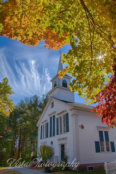 Church with Mares tails above and fall foliage below