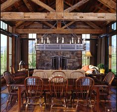 Open concept dining and living in this reclaimed barn and log home in Montana.  Love all of the windows!
