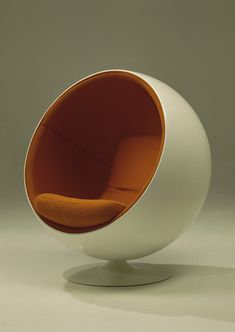 I am totally going to track one of these things down. [Globe Chair / Eero Aarnio, 1965]