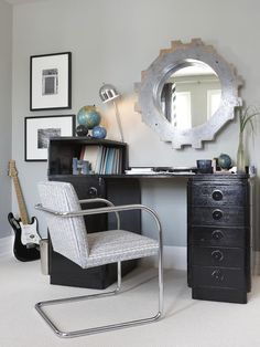 Gray, black and white as color scheme for a teen boy bedroom. Interesting cog-like mirror above the black painted desk. (Sarah Richardson)