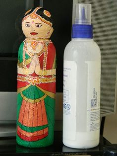 This plastic bottle doll (glue bottle) is covered with tissue paper and colored with Acrylic colors. Waste Bottle Craft, Reuse Plastic Bottles, Plastic Bottle Crafts, Wine Bottle Crafts, Ant Crafts, Diy Arts And Crafts, Creative Crafts, Creative Art, Waste Art