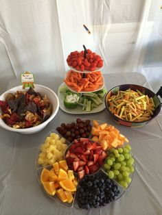 """Art party snack table had """"paint chips"""" (chips made from colorful veggies and blue corn), fresh veggies with ranch dip in a green pepper, Veggie Straws, and a colorful fruit tray."""