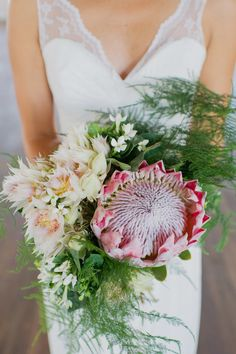 King Protea and Fern Bridal Bouquet | Karma Flowers | Christina Lilly Photography https://www.theknot.com/marketplace/christina-lilly-photography-long-branch-nj-561071