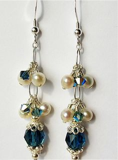 Safia Joubert - Sterling silver earring hooks with Swarovski® pearls and crystals.