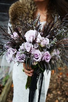 lavender rose bouquet - photo by Birke Photography http://ruffledblog.com/enchanted-forest-halloween-wedding