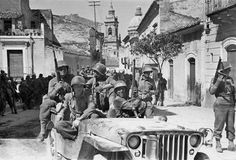 US Army Rangers ride into town in Sicily in the legendary Jeep. The M1 Garand is the main weapon. 1943.