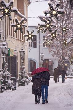 It is the most wonderful time of year!!! I would enjoy this if I could trade places with that couple and have my partner next to me strolling down the snow filled streets at Christmas time!!!...lol