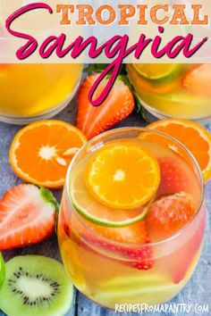 Here is an easy five ingredients tropical sangria recipe made with white wine, pineapple juice, passionfruit juice, dark rum and tropical fruits.This White Wine Sangria is just the cool refreshing treat that you need. #tropicalsangria #sangria #whitesangria #whitewinesangria #easywhitewinesangria #whitewinesangriaforacrowd #whitesangria #pineapplesangria #whitesangriarecipe