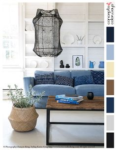 beach style living room with color palette, blue and white interiors, indigo throw pillows, distressed wood coffee table, industrial coffee table, white shiplap walls