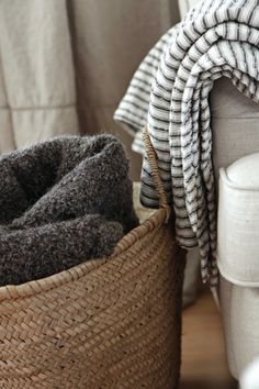 neutral vignette of textures + basket + ticking stripe