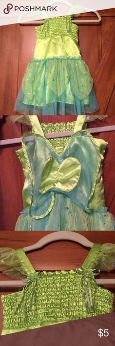 Dolly and me girls Tinker Bell dress size 4. This dress is in good used condition with some minor signs of wear on the front. It is an adorable costume Tinker Bell like dress and has a lot of love and life left! Consider bundling with other girls items for an awesome discount! Dollie & Me Costumes
