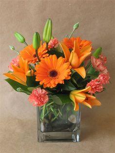 Orange gerberas and liliums