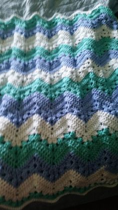 Pattern: 6 day kids blanket. Yarn: Premier Sweet Roll Spearmint Pop. Given to Terwilligers for grandson July 2018