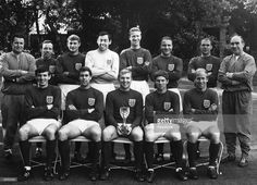 England's triumphant World Cup winning team. With the Jules Rimet Trophy are (back row, left to right) Harold Shepherdson, Nobby Stiles, Roger Hunt, Gordon Banks, Jackie Charlton, George Cohen, Richard Wilson and manager Alf Ramsey; (front row) Martin Peters, Geoff Hurst, Bobby Moore, Alan Ball and Bobby Charlton.