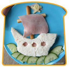 A deconstructed sandwich in the shape of a ship. A hearty lunch for a young pirate.