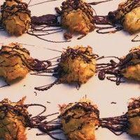 chocolate macarons with orange ganache