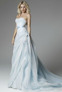 I love the way that this dress still kind of has the classic white appeal, but with the soft hue of blue interwoven.