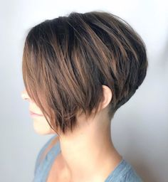 Tapered Pixie with Long Side Bangs This pixie haircut is short in the back, with a lot of volume on top, and you have long bangs to play with. Keep them straight or use a conical iron to shape some easy curls. This way you'll get a romantic look, perfe Short Hairstyles For Thick Hair, Haircut For Thick Hair, Short Pixie Haircuts, Short Hair With Layers, Pixie Hairstyles, Short Hair Cuts, Curly Hair Styles, Layered Hairstyles, Party Hairstyles
