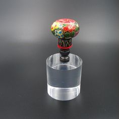 Custom Lamp Finial with a Hand Painted Russian Style Floral Decoration on Black Background by TheFineFinial on Etsy