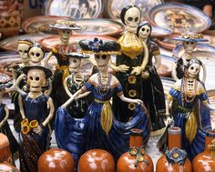 Lady Skeletons Mexico - Skeletal ladies encountered at the Day of the Dead market in Patzcuaro, Michoacan, Mexico. These ceramic pieces were made in Capula, near Morelia.
