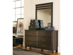 Six deep drawers in the Dakota Skyline Queen Bedroom profile dresser mean plenty of room for storage.