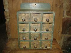 Circa 1840-1890 12 drawered and measures 18''h x 13 3/8''w x 9 1/2''d in all original true age appropriate condition.havingawesome primitive appeal and authentic character its of a greatold original green paint with early old original rare ochre painted drawers having remnants of an early green paint on them. the drawers appear to be earlier than the chest itself, the drawers are small square nailed and date earlier 1800s and the chest construction is of old rounder nails