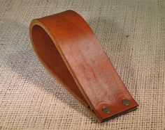 Leather doorstop Simple leather doorstop by backerton on Etsy. Could we make this out of an old belt?