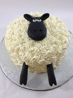 Buttercream sheep cake with fondant face and legs.
