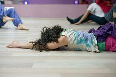 Вrunette woman lying on the floor in the hall