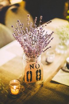 Sweet and simple lavender DIY centerpieces with burlap table numbers