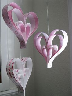 Create a heart chandelier made out of craft papers, magazines and strings.