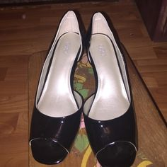 Black pumps Brand new pair of black patent Cato pumps. Never worn. I thought I could navigate wearing but only walking in the house with them on. Not leather. In excellent condition. Open peep toe. Totally cute and goes with everything. Cato Shoes Heels