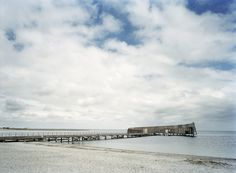 Built by White arkitekter AB in Kastrup, Denmark with date 2004. Images by Ole Haupt. Reaching out into the Øresund from Kastrup Strandpark in Kastrup, Kastrup Sea Bath forms a living and integral part o...