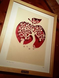 """A large papercut, hand drawn and hand cut from a single sheet of paper using a scalpel. The paper is hammered cream and the cut floats over a red background casting beautiful shadows.Framed in a large, luxury beech wood box frame, double mounted and signed on the reverse of the cut and the mount. Finished with the engraved Paper Panda tag. Complete size 12x15"""".Please note this is also a template that is sold in the shop for you to cut yourself, hence the lower than usual pr..."""