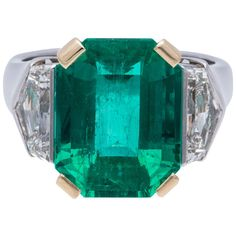 Emerald Diamond Gold Platinum Ring | From a unique collection of vintage more rings at http://www.1stdibs.com/jewelry/rings/more-rings/