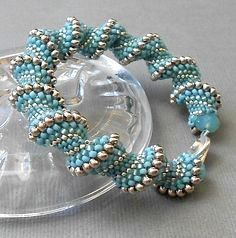 This powder blue is such a beautiful color. It is so delicate next to the silver beads. It could be a pretty flower in your spring garden. A cellini