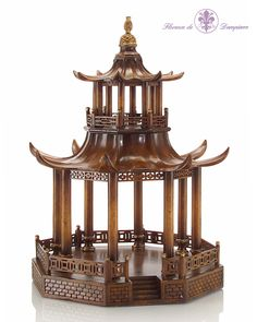 24.6Hx18.5Wx18.5D All of Europe followed the chinoiserie fashion of Versailles. Continue on that road and display this stunning wood pagoda on your table.