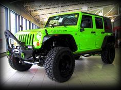 2012 Gecko Green Jeep Wrangler Rubicon-2 inch lift with Winch, front and rear bumpers, bead lock tires