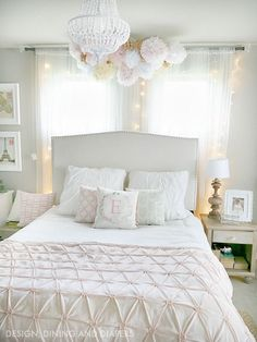 Girls Bedroom Design: Bed with twinkling lights behind it