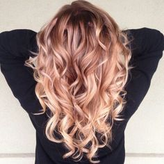 Peachy pink hair colour.