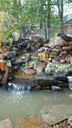 A new Pondless Waterfall is born. We used several different types of stone on this one. Turned out very unique. This is the view from the back patio and the window as well. Backyard Waterfalls, Types Of Stones, Back Patio, Water Features, Landscape Design, Pond, Window, Spaces, Unique